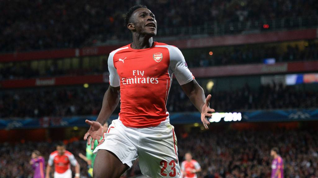 Arsenal's Danny Welbeck celebrates scoring his side's fourth goal to complete his hat-trick during the UEFA Champions League match at The Emirates Stadium, London. PRESS ASSOCIATION Photo. Picture date: Wednesday October 1, 2014, See PA story SOCCER Arsenal. Photo credit should read: Andrew Matthews/PA Wire. .