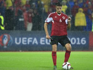 ELBASAN, ALBANIA - OCTOBER 08: Berat Xhimshiti of Albania in action during the Euro 2016 qualifying football match between Albania and Serbia at the Elbasan Arena in Elbasan on October 08, 2015. (Photo by Srdjan Stevanovic/Getty Images)