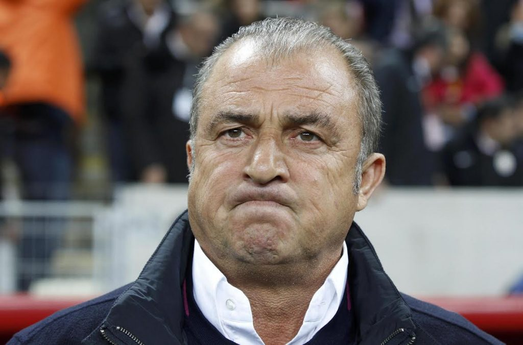 Galatasaray's coach Fatih Terim reacts before the start of their Champions League quarter-final second leg soccer match against Real Madrid in Istanbul April 9, 2013.    REUTERS/Osman Orsal (TURKEY  - Tags: SPORT SOCCER)
