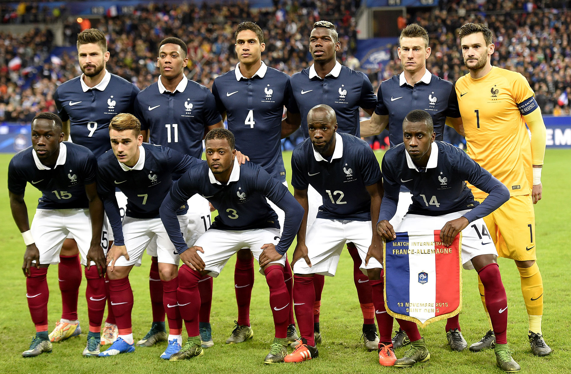 (up-from L) France's forward Olivier Giroud, forward Anthony Martial, defender Raphael Varane, midfielder Paul Pogba, defender Laurent Koscielny and goalkeeper Hugo Lloris, (down-from L) France's defender Bacary Sagna, forward Antoine Griezmann, defender Patrice Evra, defender Eliaquim Mangala and  midfielder Blaise Matuidi pose during the friendly football match France vs Germany, on November 13, 2015 at the Stade de France stadium in Saint-Denis, north of Paris. AFP PHOTO / FRANCK FIFE        (Photo credit should read FRANCK FIFE/AFP/Getty Images)