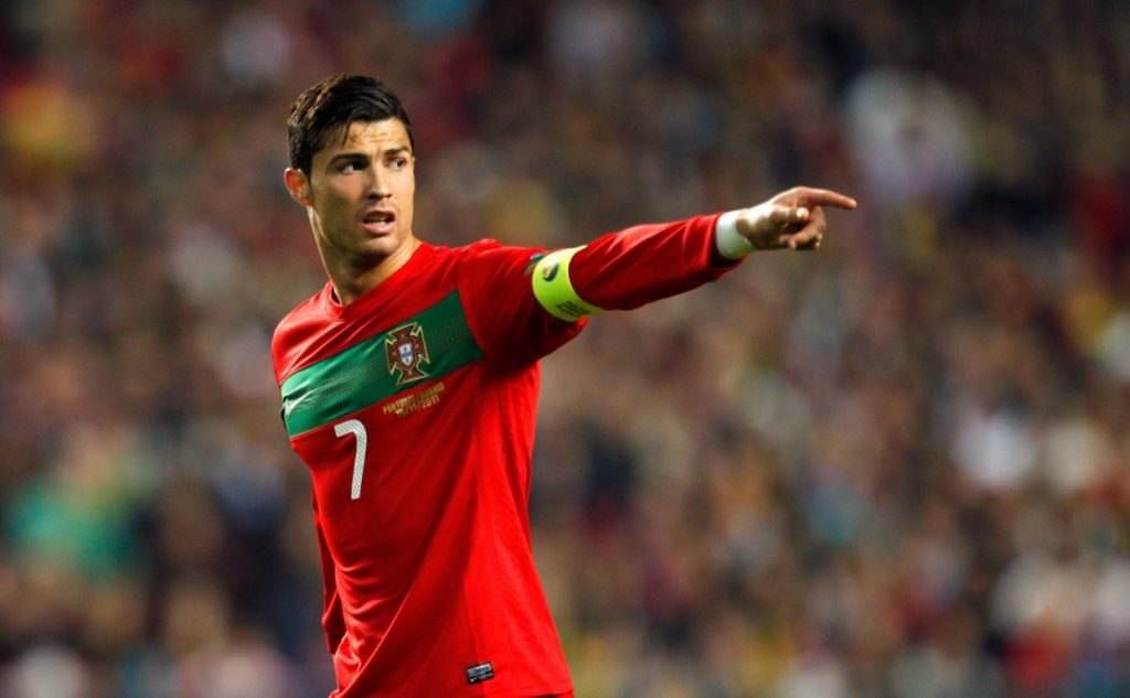 Portugal's  Cristiano Ronaldo gestures during their Euro 2012 play-offs second leg match with Bosnia Tuesday, Nov. 15 2011, at the Luz stadium in Lisbon. Portugal defeated Bosnia 6-2 to qualify for the 2012 finals. (AP Photo/Armando Franca)