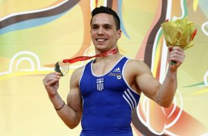 epa04710493 Greek gymnast Eleftherios Petrounias  holds his gold medal after winning the Men's rings final at the Men's European Artistic Gymnastic Championships in Montpellier, France, 18 April 2015.  EPA/GUILLAUME HORCAJUELO