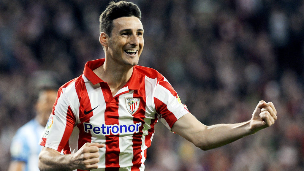 Athletic Bilbao's forward Aritz Aduriz celebrates after scoring during the Spanish league football match Athletic Club Bilbao vs Malaga CF at the San Mames stadium in Bilbao on April 14, 2014.   AFP PHOTO/ RAFA RIVAS        (Photo credit should read RAFA RIVAS/AFP/Getty Images)